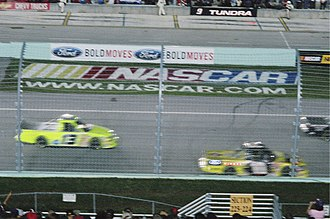 2006 NASCAR Craftsman Truck Series - Terry Cook (10) and Kerry Earnhardt (13) line up before the Ford 200.