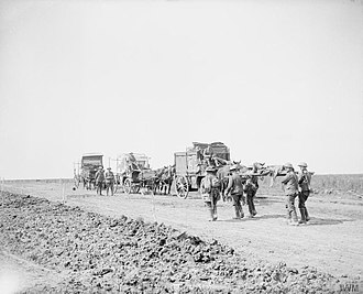 56th (London) Infantry Division - Horse ambulances of the 2/1st London Field Ambulance, Royal Army Medical Corps of the 56th Division on a track running east of Maricourt-Montauban Road, with wounded on stretchers just arriving, September 1916.