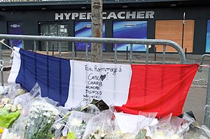 Hypercacher Kosher Supermarket siege - Flowers and a French Flag outside the Hypercacher Jewish Market