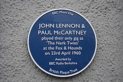 Photo of The Nerk Twins, John Lennon, and Paul McCartney blue plaque
