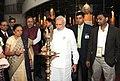The Prime Minister, Shri Narendra Modi lighting the lamp at Dandi Kutir, in Mahatma Temple premises, Gandhinagar on January 08, 2015. The Chief Minister of Gujarat, Smt. Anandiben Patel and other dignitaries are also seen.jpg