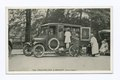 The Traveling Library, Staten Island (children at side of old truck looking at displayed books) (NYPL b15279351-105170).tiff