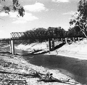 Tilpa - The Darling River at Tilpa c. 1945.  The punt can be seen behind the new bridge