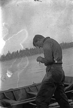 Thomson fishing in Algonquin Park.