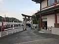 Torii of Kitaoka Shrine and Kyushu Shinkansen.jpg