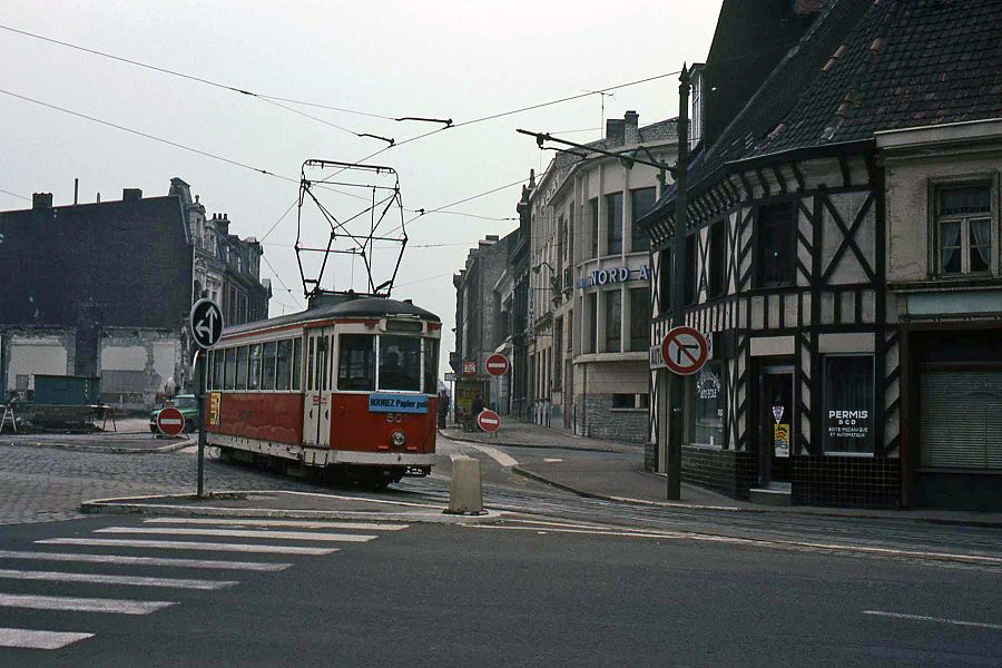 """Old mongy tram in tourcoing. The tram now uses another route. Tram is coming from """"rue Faidherbe"""" and turning into """"rue Carnot""""."""