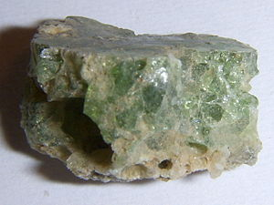 Small piece of trinitite, detail, showing side...