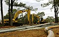 Two Caterpillar excavators at Charleston AFB.jpg