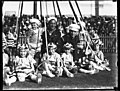 Two United States sailors with children around a maypole possibly at the Vice-Regal Garden Party (8471157361).jpg