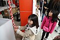 Two girls ring the bells in a shrine in Kumamoto, Japan; January 2014.jpg