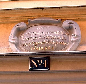 Tyska Skolgränd - Sandstone cartouche at Number 4.
