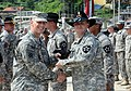 U.S. Army Maj. Gen. Thomas S. Vandal, left, the commanding general of the 2nd Infantry Division presents the Draper Armor Leadership Award to 1st Sgt. Robert Dicks, assigned to Alpha Troop, 4th Squadron, 7th 130821-O-ZZ999-093.jpg