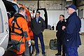 U.S. Coast Guard Petty Officer 2nd Class Zach Painter, left, a rescue helicopter crew member assigned to Coast Guard Air Station Kodiak, Alaska, gives a preflight safety briefing to Rear Adm. Thomas P. Ostebo 120725-G-GW487-004.jpg