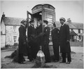 U.S. Coast Guardsmen make use of a telephone booth in Scotland. They are on liberty from their ship, a Coast Guard - NARA - 513167.tif
