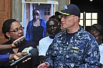 U.S. Navy Cmdr. Brad Fillius, the officer-in-charge of the high-speed vessel Swift (HSV-2), speaks to Congolese reporters during a community relations event at a local orphanage as part of Africa Partnership 120904-F-BU402-140.jpg