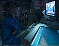 U.S. Navy Operations Specialist Seaman Destini Hall monitors operations in the combat information center aboard the guided missile destroyer USS Gravely (DDG 107) in the Mediterranean Sea May 28, 2013 130528-N-KA046-034.jpg