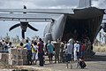 U.S. Sailors assigned to the aircraft carrier USS George Washington (CVN 73), Marines and Filipino civilians help unload supplies from a Marine Corps HC-130 Hercules aircraft attached to Marine Wing Support 131116-N-TE278-399.jpg