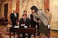 U.S. Secretary of State Condoleezza Rice assists newly sworn-in Ambassador Mark Dybul.jpg