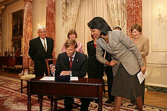Mark R. Dybul - Mark R. Dybul with Condoleezza Rice, Laura Bush, and his family at his swearing-in on October 10, 2006