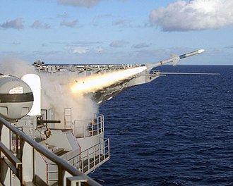 Nimitz-class aircraft carrier - The firing of a Sea Sparrow missile from the Theodore Roosevelt. A Phalanx CIWS is in the left of the image.