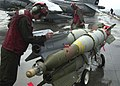 US Navy 030325-N-6610T-536 Marine Corps Ordnancemen move bombs on the flight deck aboard USS Bataan (LHD 5).jpg
