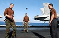 "US Navy 030327-N-1290G-003 Plane Captains take a relax and play some ""hackey-sack"", on the flight deck aboard the aircraft carrier USS Harry S. Truman.jpg"