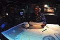 US Navy 030911-N-1671M-005 Operations Specialist 3rd Class Zakia Miller from Philadelphia, Penn., precisely plots the course of USS Bridge.jpg
