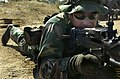 US Navy 030927-N-5362A-001 A U.S. Navy SEAL takes aim with an M-60 machine gun.jpg
