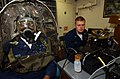 US Navy 040202-N-9288T-045 Fire Controlman 1st Class Ritchie Andrews, of Laurelton, N.Y., has a fit test performed on his MCU-2-P gas mask while Damage Controlman 3rd Class Travis Ross, from Delavan, Wis., monitors the readings.jpg