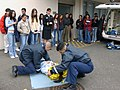 US Navy 040323-N-0000W-015 Hospital Corpsman Fernando Prieto and Hospital Corpsman Raulito Galgana demonstrate lifesaving techniques in the parking lot outside the Emergency Room of U.S. Naval Hospital Yokosuka, Japan.jpg