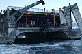 US Navy 040710-N-6932B-011 Crewmen assigned to Naval Special Clearing Team ONE (NSCT 1), are hoisted aboard High-Speed Vessel Swift (HSV 2) after deploying an unmanned underwater vehicle.jpg