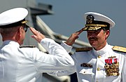 US Navy 040806-N-8148A-077 Rear Adm. Robert J. Cox, right, returns a salute to Rear Adm. Robert T. Moeller while taking command of Cruiser Destroyer Group ONE (CCDG-1)