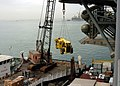 US Navy 050110-N-8801B-159 A forklift is craned aboard the amphibious assault ship USS Essex (LHD 2) during a port call in Bahrain.jpg