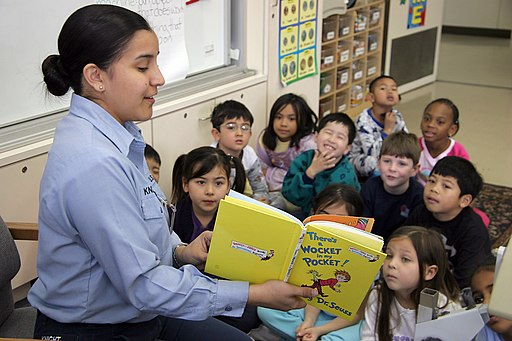 US Navy 050302-N-1113S-004 Yeoman 3rd Class Inez Knight, assigned to the Administration Department on board U.S. Naval Air Facility Atsugi, Japan, reads to a first-grade class
