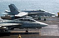 US Navy 060107-N-0685C-005 An F-A-18 Hornet assigned to the Golden Warriors of Strike Fighter Squadron Eight Seven (VFA-87) and an F-14D Tomcat assigned to the Tomcatters of Fighter Squadron Three one (VF-31) prepare for launch.jpg