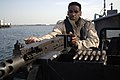 US Navy 060217-N-8298P-001 Boatswain's Mate 2nd Class Michael Coore assigned to the Naval Coastal Warfare Squadron Two six (NCWRON-26) loads his gun prior to his patrol in the costal waters of the Persian Gulf.jpg