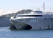 US Navy 061121-N-2716P-002 U.S. Navy High-Speed Vessel Swift (HSV 2) maneuvers through Yokosuka Bay, as it departs Commander Fleet Activities Yokosuka, Japan following a routine port visit