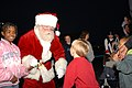 US Navy 061127-N-7987M-039 Santa greets his guest during Operation Christmas at the Army National Guard Armory.jpg