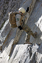 US Navy 071017-M-0173F-027 Hospital Corpsman 2nd Class Roger Ayala, attached to Delta Company, 1st Reconnaissance Battalion, 1st Marine Division, watches his footing while rappelling at the Land Traverse Assault course
