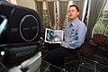 US Navy 071114-N-4879G-483 Hospital Corpsman 1st Class Sean Ehrsam, a medical laboratory technician aboard the nuclear-powered aircraft carrier USS Harry S. Truman (CVN 75), reads the Disney-Pixar book.jpg