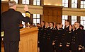 US Navy 071217-N-0606B-003 Chief of Naval Operations Adm. Gary Roughhead administers the oath of office to 35 ROTC graduates at Purdue University in West Lafayette during a Tri-Service Commissioning Ceremony at the university.jpg