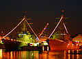 US Navy 071218-N-2638R-001 Holiday lights illuminate the Arleigh Burke-class guided-missile destroyers USS Lassen (DDG 82) and USS McCampbell (DDG 85) at Fleet Activities Yokosuka.jpg