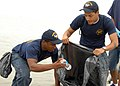 US Navy 080606-N-3548M-087 Aviation Boatswain's Mate (Handling) Airman Fredrick Stoneham, left, and Hull Maintenance Technician Fireman Gerard Wilson, assigned to the Pre-Commissioning Unit (PCU) George H. W. Bush (CVN 77), pic.jpg