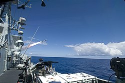US Navy 080714-N-8135W-176 The Canadian frigate HMCS Regina (FFH 334) fires a Harpoon anti-ship missile during a Rim of the Pacific (RIMPAC) sinking exercise.jpg