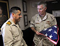 US Navy 090330-N-2606F-899 Rear Adm. Terence McKnight, commander of Combined Task Force (CTF) 151, presents an American Flag to Capt. Cenk Dalkanat, commanding officer of the Turkish Naval Forces frigate TCG Giresun (F-491).jpg