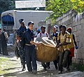 US Navy 100128-N-1831S-057 Crewmembers local Haitians takes supplies from the back of a U.N. truck to drop off at the Operation Hope for Children of Haiti clinic in Killick.jpg