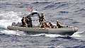 US Navy 100708-N-7058E-161 A visit, board, search and seizure team approaches USNS Bridge (T-AOE 10) in a rigid-hull inflatable boat.jpg