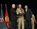 US Navy 101115-N-8273J-031 Chief of Naval Operations (CNO) Adm. Gary Roughead presents the Wounded Warrior Hiring and Support award to Vice Adm. Ke.jpg