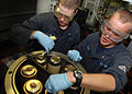 US Navy 110127-N-0619M-180 Gas Turbine Systems (Mechanical) Firemen Devon Grier and Jake Hanzlik calibrate a filter responsible for cleaning the sh.jpg