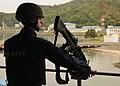 US Navy 110128-N-5620H-445 Gunner's Mate 2nd Class Aron Miltenberger stands watch of Sepangar Bay aboard USS Frank Cable (AS 40).jpg